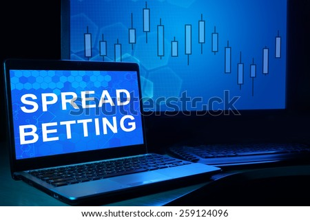 Computer with words spread betting. Trading concept. - stock photo