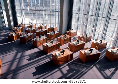 Computer workstations in a modern library - stock photo