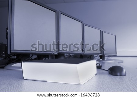 Computers and training book in laboratory - stock photo