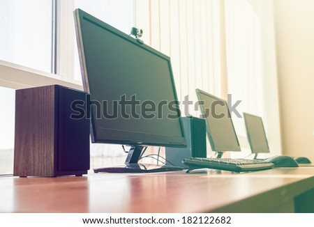 Computers in office filtered - stock photo