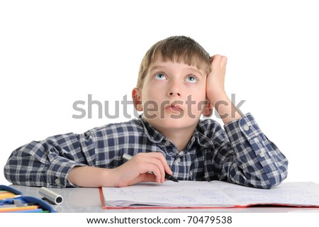 concentrated and enthusiastic schoolboy doing homework isolated on white - stock photo