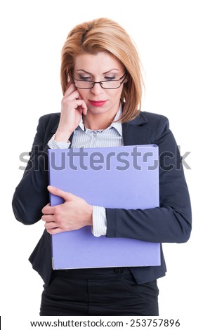 Concentrated business woman holding a purple folder - stock photo