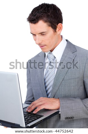 Concentrated businessman using a laptop isolated on a white background