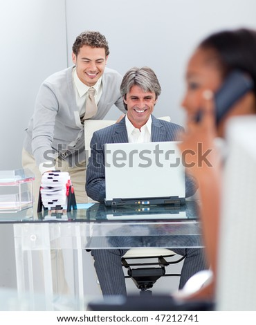 Concentrated businessmen working at a computer in the office