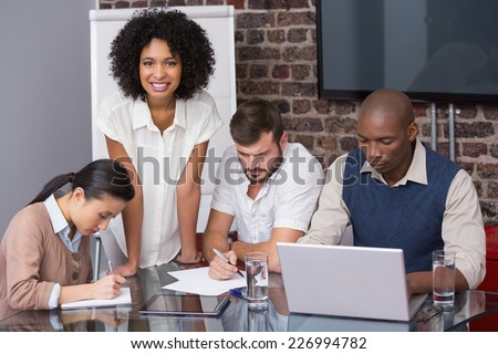 Concentrated creative business team in meeting at office - stock photo