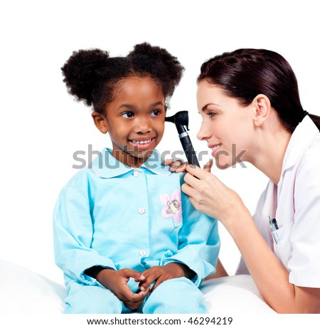Concentrated doctor checking her patient's ears against a white background - stock photo