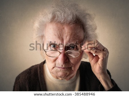 Concentrated elderly woman - stock photo