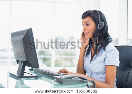 Concentrated operator answering a call in office - stock photo