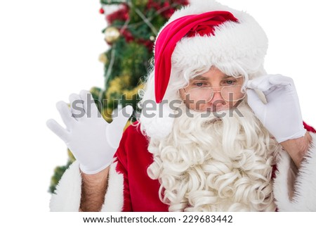Concentrated santa claus doing gesture on white background