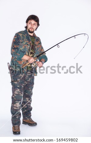 Concentrated young fisherman holding a rod in his hands - isolated on white