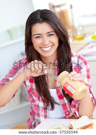 Concentrated young having a breakfast in the kitchen at home - stock photo