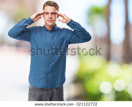 concentrated young-man standing - stock photo