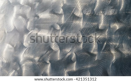 Concentric brushed metal sheet, polished and shiny alloy background - stock photo