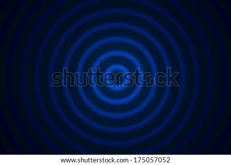 Concentric circles on a black background - stock photo