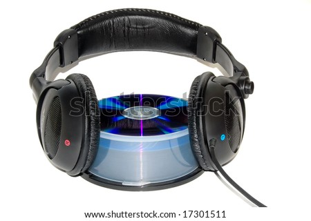 Concept: a earphones on to of a CD - stock photo
