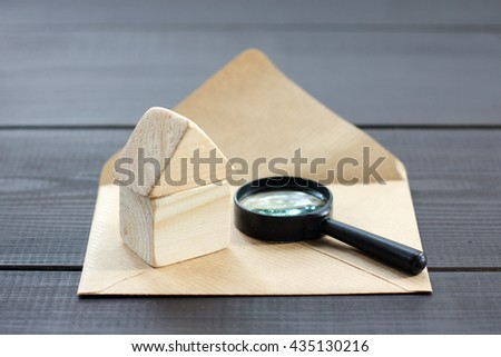 concept a thorough analysis, post real estate property by magnifying-glass / Search offers individual construction - stock photo