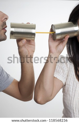 Concept about communications with 2 tin cans and a string. - stock photo