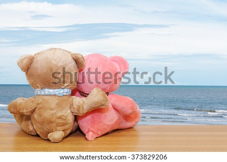 Concept about love and relationship teddy bear sitting at the sea - stock photo