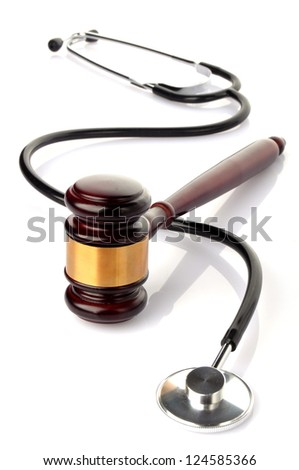 concept about medical lawsuit, stethoscope and gavel on white background - stock photo