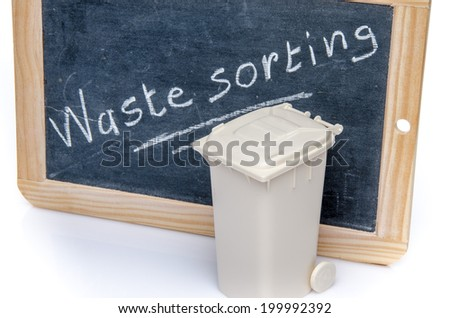 Concept about waste sorting with a trash can, isolated on white - stock photo