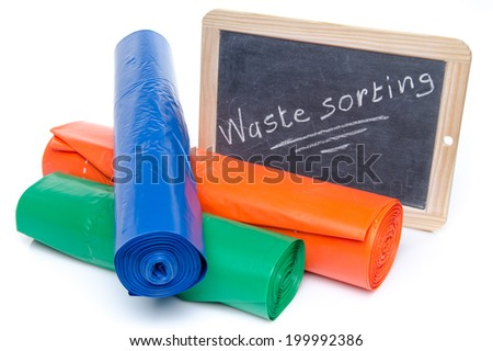 Concept about waste sorting with trash bags in different colors, isolated on white - stock photo