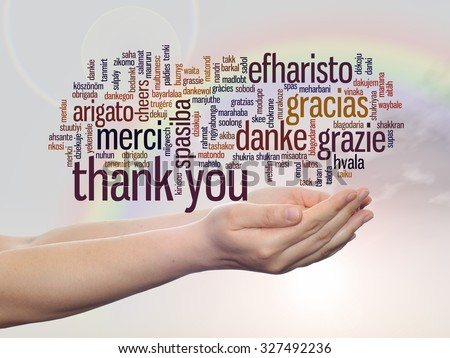 Concept abstract thank you word cloud held in hands in different languages or multilingual for education,Thanksgiving Day, appreciation, multicultural, friendship, tourism travel over rainbow sky - stock photo