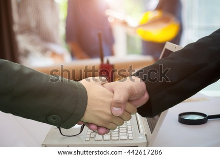Concept Agreement between the employer and architect Nick and desk of Architectural project in construction site or office with mining light