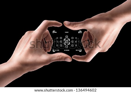 Concept (Always in focus)  Hands create camera screen isolated on black background - stock photo