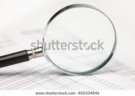 Concept business analysis of data. A magnifying glass on a table. Reporting business documents. - stock photo
