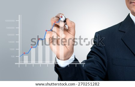 Concept. Business hand drawing a graph - stock photo