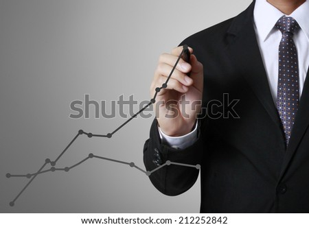 concept business man writing over target graph - stock photo