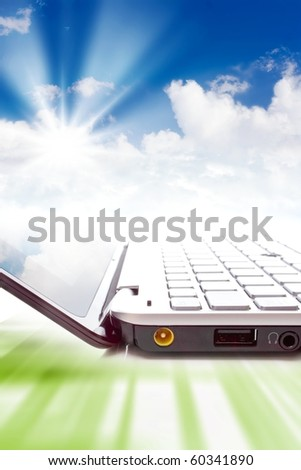 Concept - cloud computing, notebook and clouds in sky - stock photo