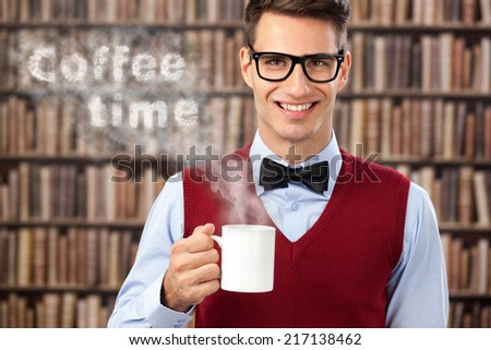Concept, coffee time, smiling male student with hot coffee - stock photo