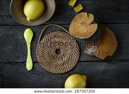 concept composition of yellow things on dark wooden background - stock photo