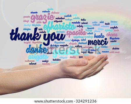 Concept conceptual abstract thank you word cloud held in hands different language, multilingual as education, thanksgiving day, appreciation, multicultural, friendship, tourism travel over rainbow sky - stock photo