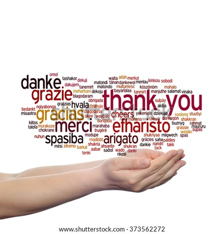 Concept conceptual abstract thank you word cloud held in hands in different languages multilingual for education or Thanksgiving Day metaphor to appreciation, multicultural, friendship, tourism travel - stock photo