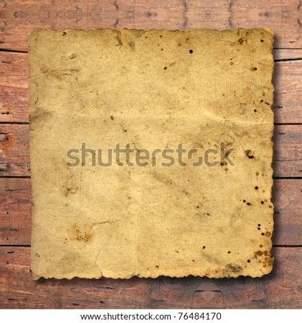 Concept conceptual old vintage brown damaged paper texture over a wood background as metaphor for aged, retro, wooden, dirty, textured, manuscript, antique, parchment, book, ancient, weathered grungy