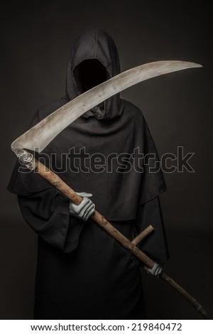 Concept: Death comes. Studio portrait on black background - stock photo