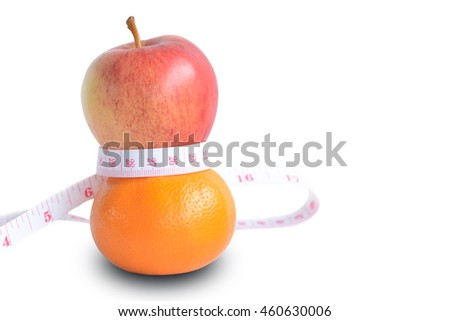Concept eat orange and apple are in good shape.Orange and apple wrapped with a tape measure. on white background