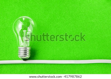 Concept ecology. Light bulb on green background with copy space - stock photo