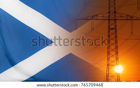Concept Energy Distribution, Flag of Scotland with high voltage power pole during sunset