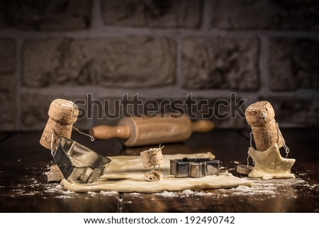 Concept family cut out biscuits, wine cork figures - stock photo