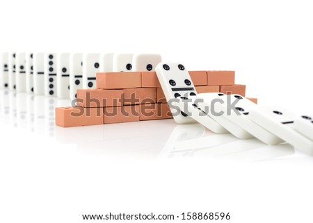 Concept for a planned Strategy to stop a domino effect - stock photo