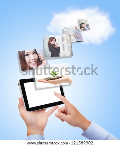 concept for business and cloud computing, Business man with tablet pc and the success in business on blue background - stock photo
