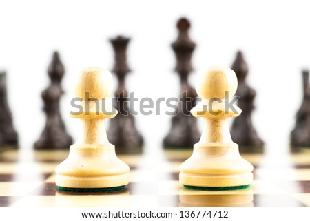 Concept for challange with elegant Stauton style chess pieces - stock photo