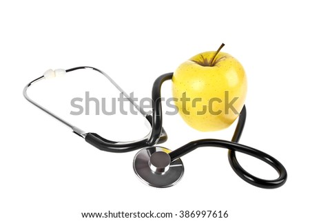 Concept for diet and healthcare - yellow apple and stethoscope on a white background