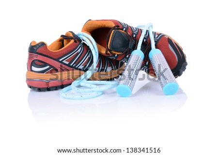 concept for exercise running shoes and skipping rope isolated on white