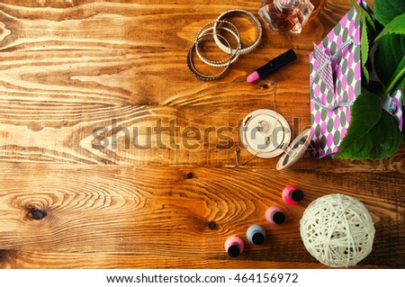 Concept for girls make up abstract wooden background.