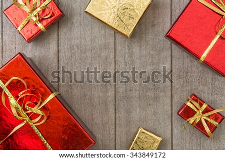 Concept for holidays with gifts on wooden background - stock photo
