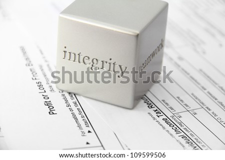 Concept for honesty and integrity in tax preparation. - stock photo